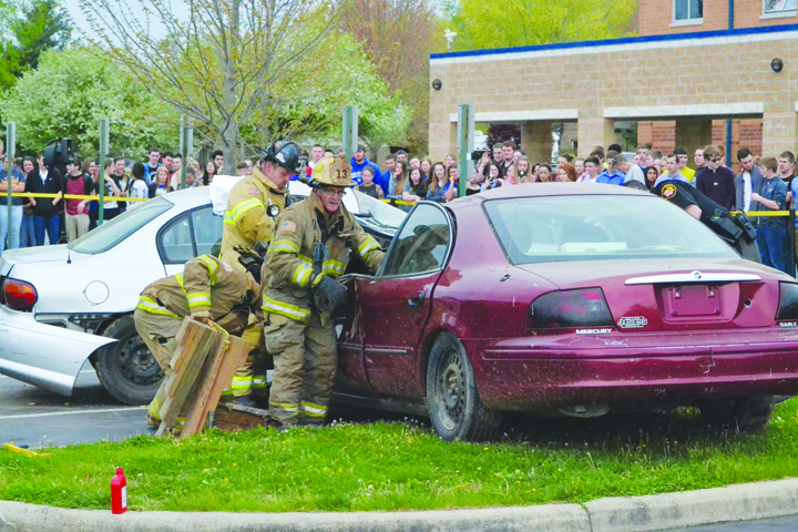 With the high school student body on hand, emergency responders take part in the Prom Promise/ Mock Accident at Manchester High School on april 21.  Photo by Mark Carpenter
