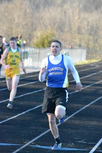 Manchester's Brendon Kessler was the winner of the 200 Meter Dash in a time of 23.93 at Tuesday's West Union Invitational. Photo by Mark Carpenter - People's Defender