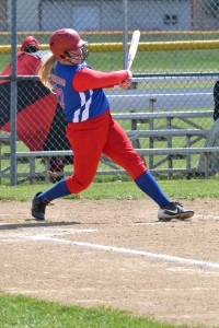 Peebles freshman McKenzie Swango takes a big cut during action from the doubleheader with New Boston.