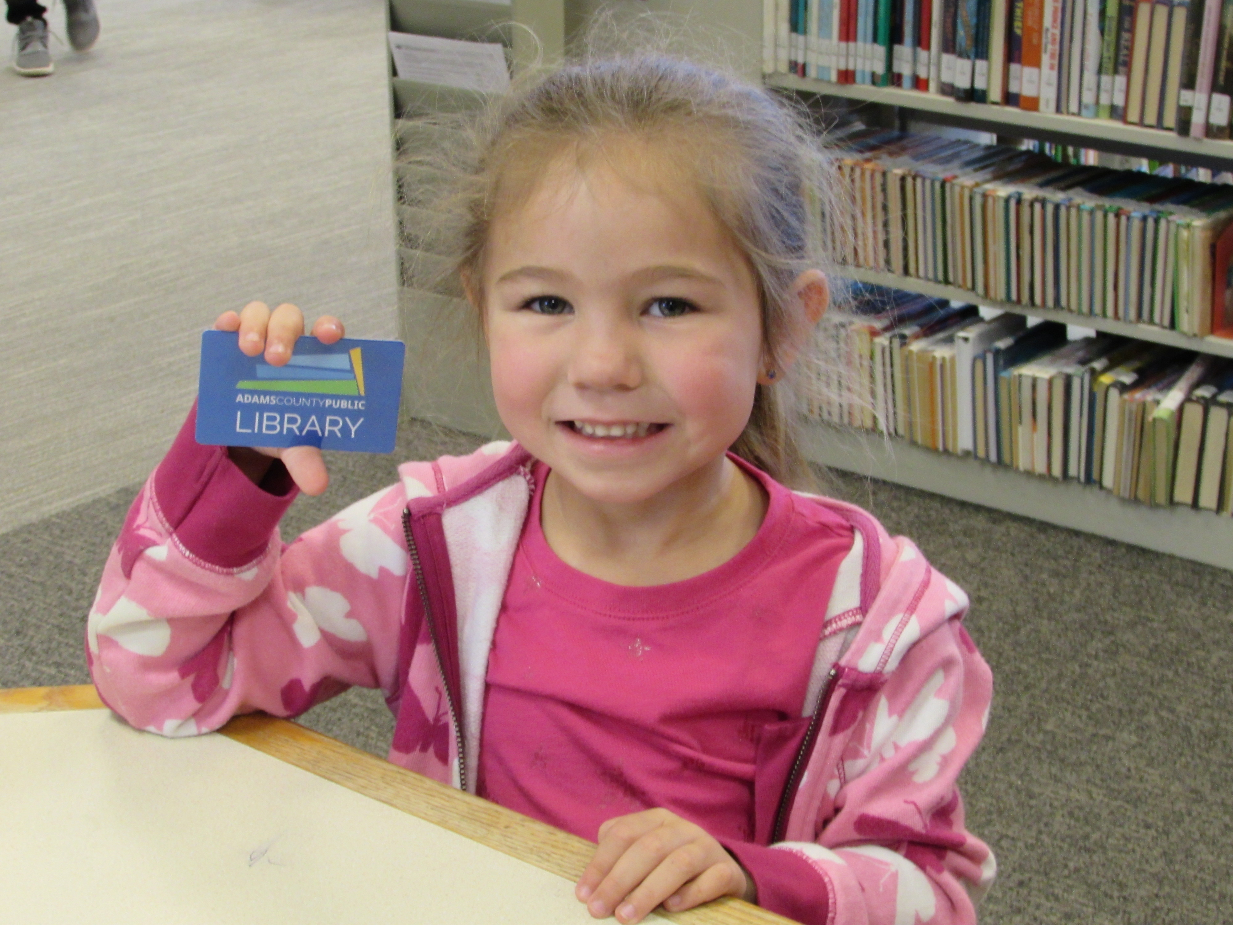 Jaylee Crum was excited to sign up for her first library card.