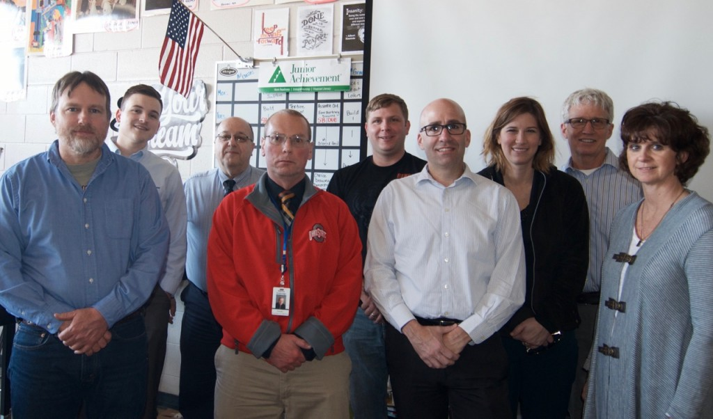 Meeting earlier this week in Peebles to continue planning for the Junior Achievement program were, from left, Dan Wickerham (Adams/Brown Recycling), Max Craft (First State Bank), Mike McCann (National Bank of Adams County), Stan Doddridge (Peebles Seventh Grade Social Studies Teacher), Paul Worley (Adams County Commissioner), Jon Linkous (National Bank of Adams County), Bethany Pistole (First State Bank), Roy Willman (Willman Facilitation), and Nancy Horvath (Merchants National Bank).