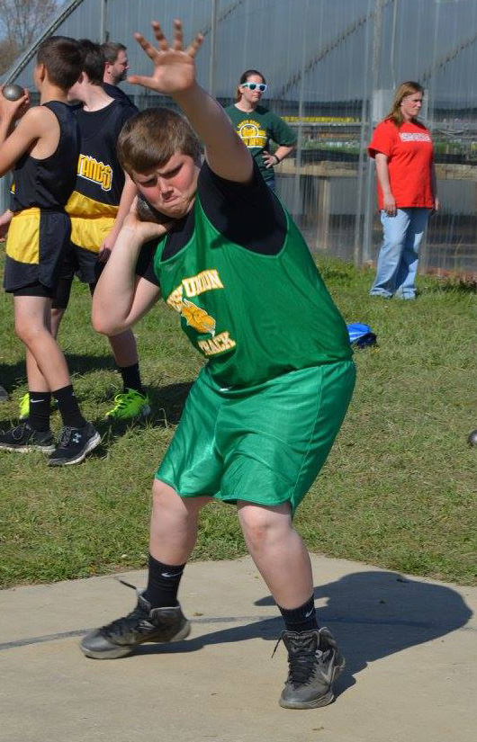 West Union hosted their annual Junior High Invitational track meet on April 15 and this young Dragon prepares for his throw in the Shot Put competition. Photo by Jamie Puckett.