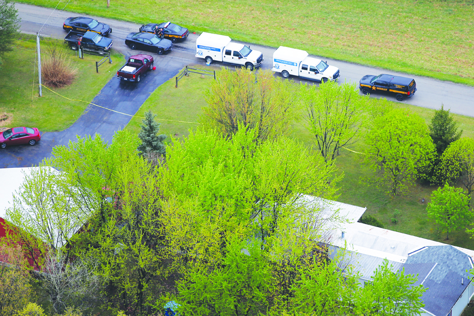 "An aerial view of 4077 Union Hill Road, one of the locations in which eight people died in an ""execution-style"" killing Friday, April 22, 2016, in Piketon, Ohio. State and local officials are conducting investigations throughout the Ohio town. Photo by Kareem Elgazzar - The Cincinnati Enquirer"
