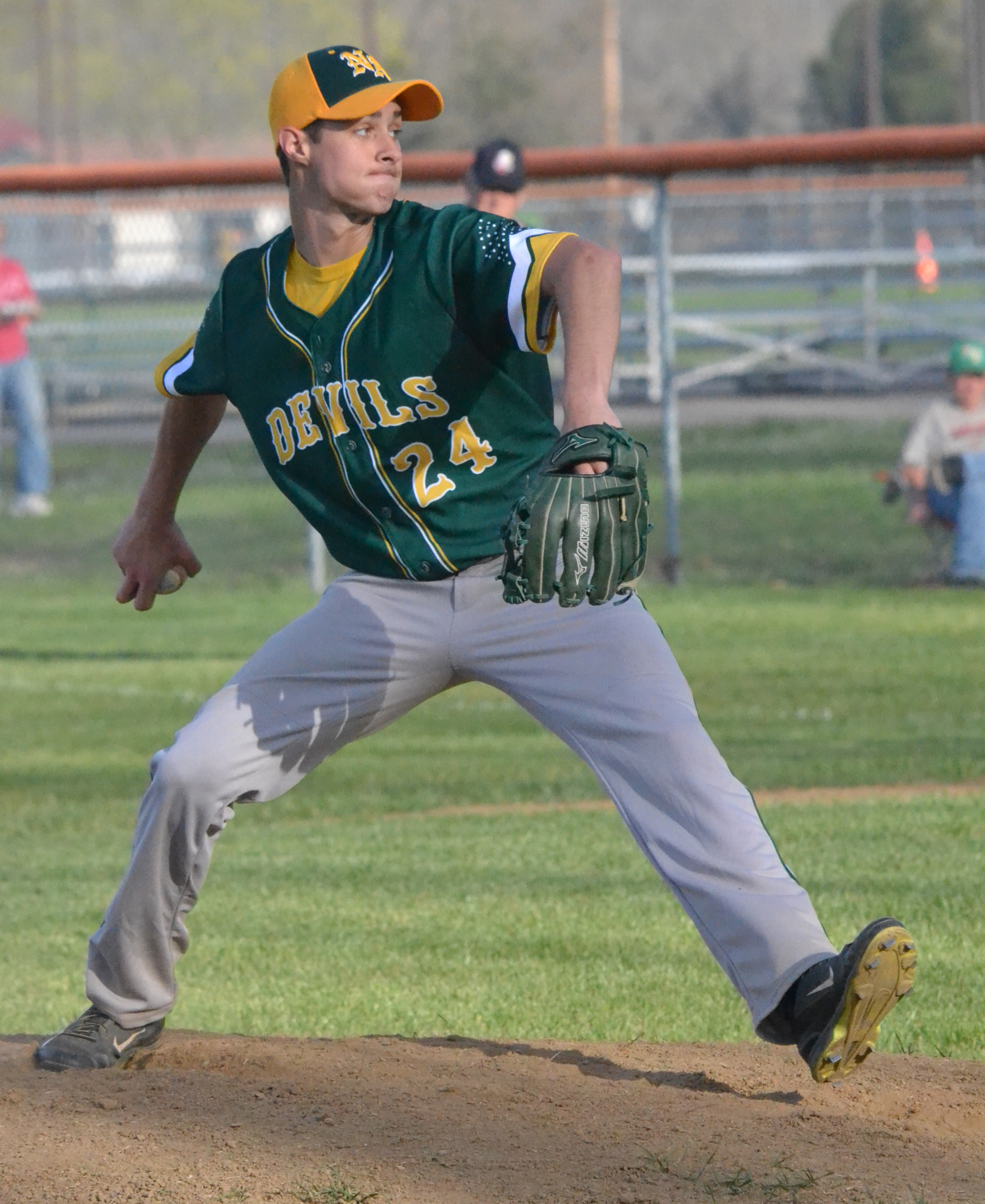 Right hander Cole Roades pitches six strong innings in relief to pick up the win as the Green Devils topped West Union 10-6.  Photo by Mark Carpenter.