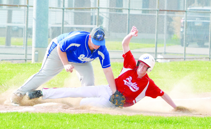 Peebles' Bostin Robinson slides safely into third base during action from the Indians' 7-0 win in Ripley on April 21.  Photo by Mark Carpenter