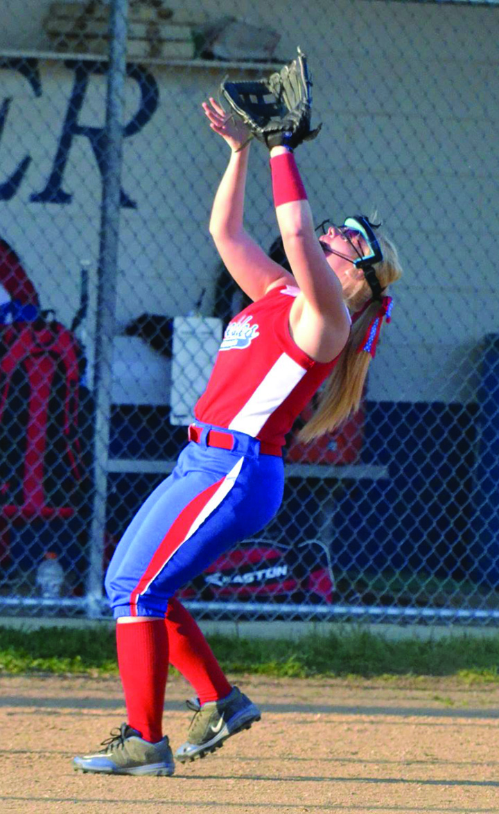 The bat and glove of senior Kaitlin Toller has been an integral part of the success of the 2016 Peebles Lady Indians.  Photo by Mark Carpenter.
