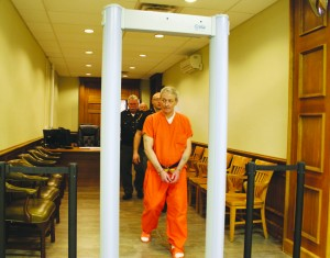 Arthur D. Moman is led from the courtroom after being found guilty of murder. Photo by Patricia Beech - People's Defender