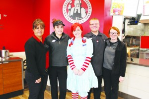Wendy's Manager Debbie Nichols, Myrtle Strange, Rachel Madden (as Wendy), J.D. Staggs, and Jessica Rothwell welcomed guests at Wendy's Customer Appreciation Day.  Photo by Patricia Beech - People's Defender