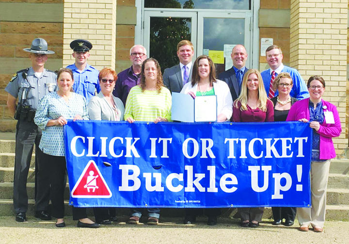 "The Adams County Commissioners met with members of the Adams County Safe Communities Coalition recently and proclaimed May 23 to June 5 as the ""Click It or Ticket"" Mobilization in Adams County and urge all citizens to always wear seat belts when driving or riding on our roadways. Pictured above: Front row, from left, Holly Johnson, Adams County Economic and Community Development Director; Debbie Ryan, Adams County Safe Communities Coordinator,; Heather Roush, Adams Brown Early Head Start; Sarah Hood, Program Director, The Counseling Center; Amanda Fraley, Fiscal Agent, Adams County Safe Communities grant; Heather Hoop, HR Director, Adams County Regional Medical Center; and Erin Meade, HR/Community Relations Assistant, Adams County Regional Medical Center; Back row, from left, Trooper Shannon Utter, OSP-Georgetown Post, Jordan Haggerty, OSP Cadet Intern; Mike Hughes, Resource Manager, Adams County Engineer's Office; Commissioner Paul Worley; Commissioner Brian Baldridge; and Commissioner Stephen Caraway."