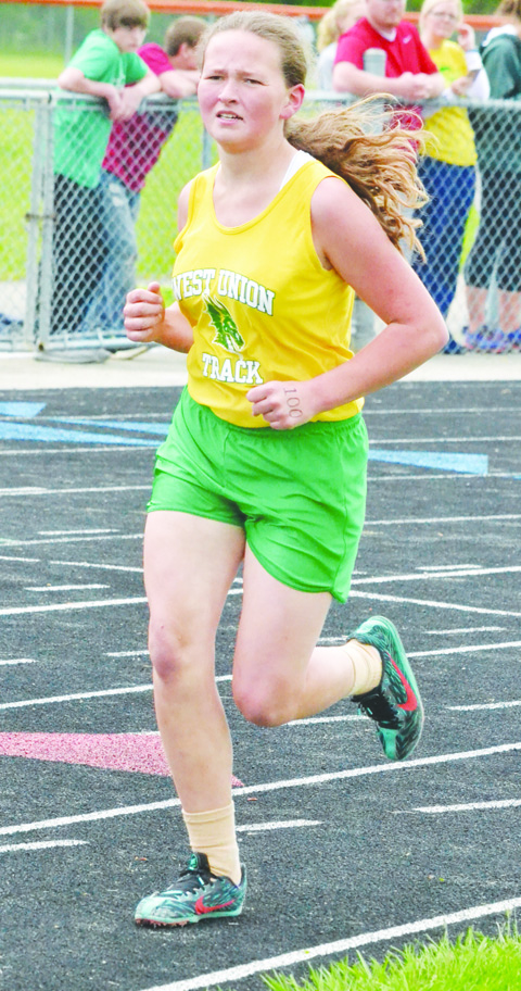 West Union 's Katrina Boldman placed fifth in the Girls 1600 Meter Run at the 2016 SHAC Junior High Track Meet. Photo by Mark Carpenter.