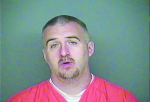 John Kenneth Fronk II, suspected of a string of robberies in the area, died after hanging himself with a sheet at the Adams County Jail.