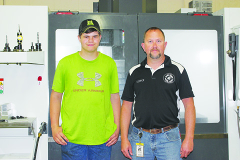 Matthew Grooms, left, with his CTC instructor Roy Cooper.