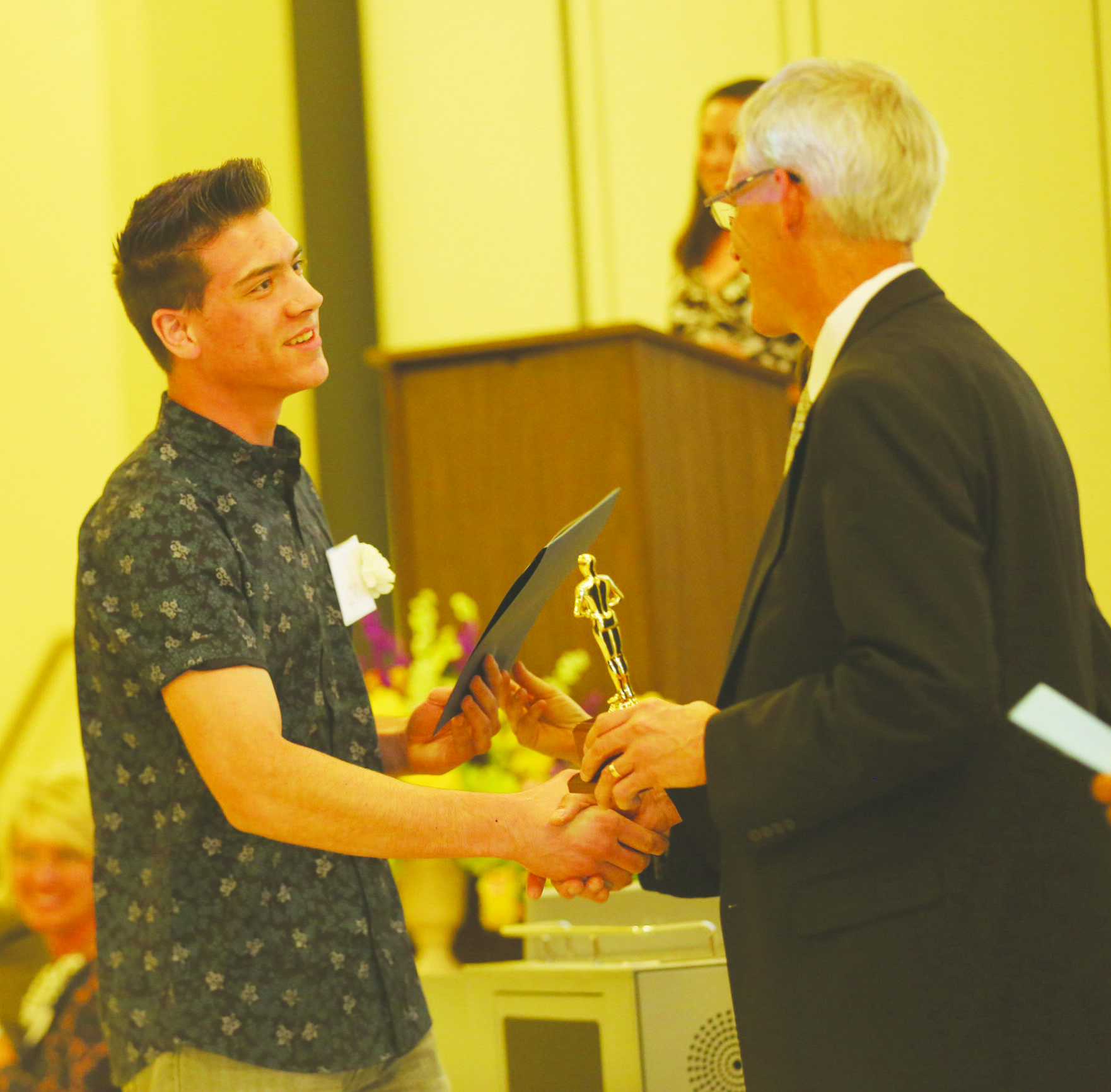Jesse Hall, Adams County Outstanding Student, left, receives his award from Richard Seas, Superintendent of the Adams County/Ohio Valley School District.