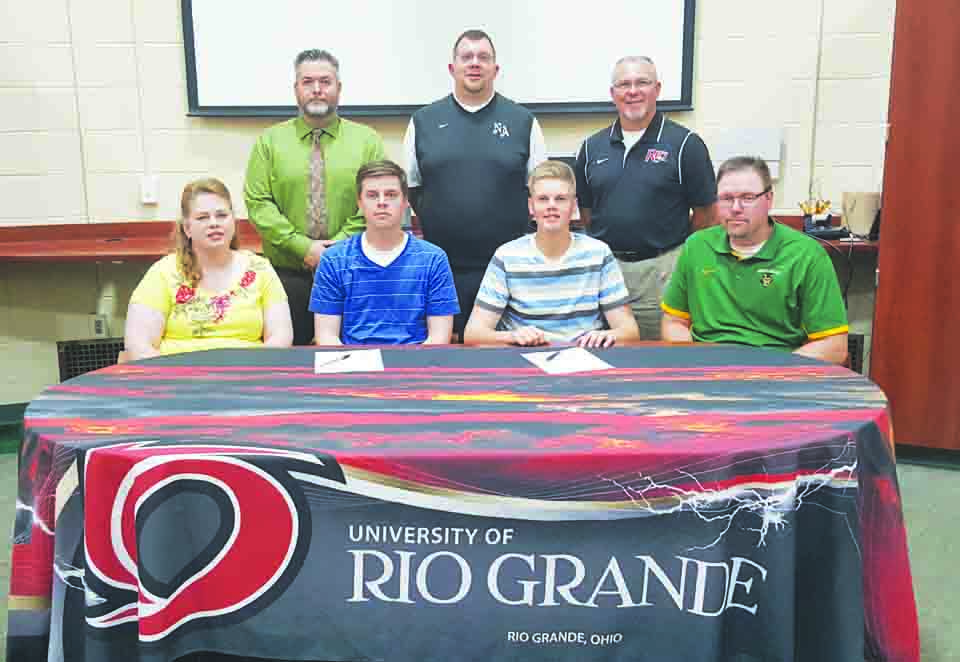 Present at the May 12 signing ceremony at North Adams High School were: Front row, from left, Christa Meade (mother), Cole Meade, Trey Meade, and Rob Meade (father); Back row, from left, Matt Young, NAHS Principal, Tony Williams, NAHS Athletic Director, and Brad Warnimont, Head Baseball Coach at Rio Grande.  Photo by Mark Carpenter.