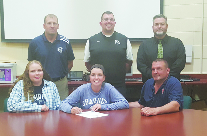 Pictured at the April 27 signing ceremony are: Front row, from left, Julie Spriggs (mother), Jade Spriggs, Charlie Spriggs (father); Back row, from left, SSU Golf Coach Dave Hopkins, North Adams Athletic Director Tony Williams, and North Adams HS Principal Matt Young.  Photo by Mark Carpenter