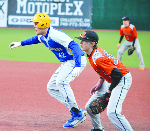 Manchester's Jared Stricklett, left, gets his secondary lead off of first base in action from last Sunday night's 10-6 defeat for the Hounds in the /Division IV district semi-finals.  Photo by Mark Carpenter.
