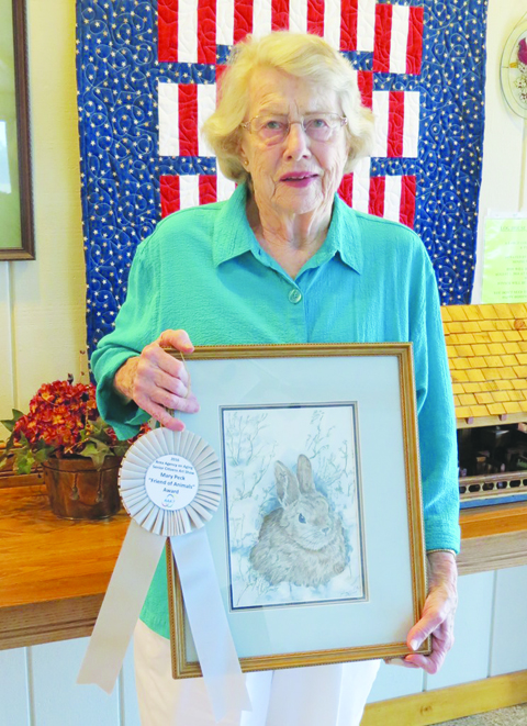 "Jo Ann White of Adams County was the winner of the 2016 ""Mary Peck Friend of Animals Award"".  She is pictured here with her winning watercolor, ""Bunny Rabbit""."