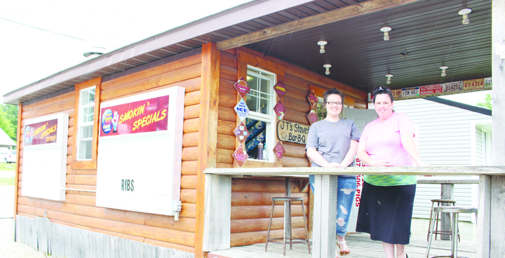 From left, Heather Mingee and Stacy Gilkison are two members of the award-winning team at JT's Stovetop BBQ in West Union.