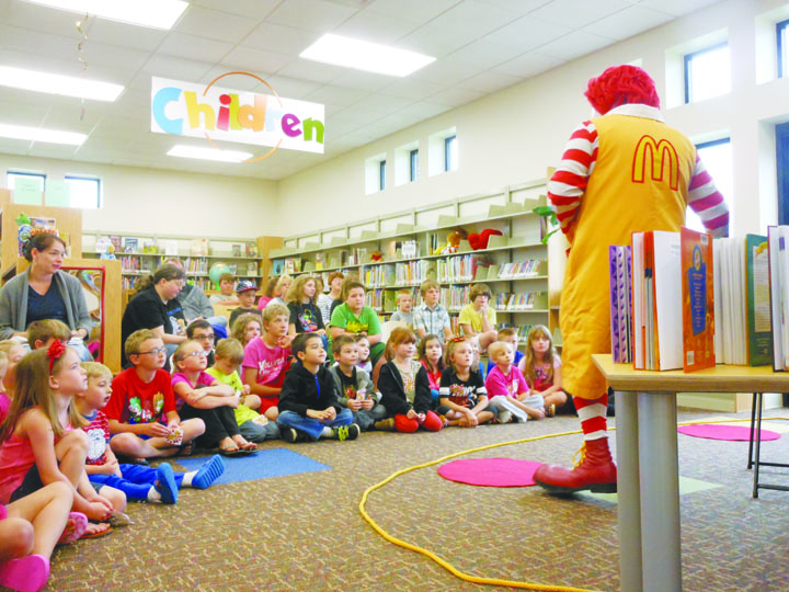 Ronald McDonald visits the North Adams Library.