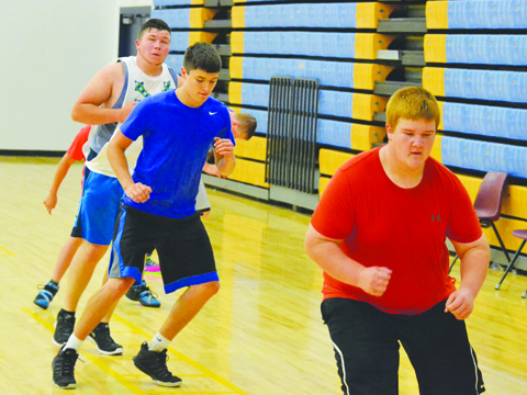 This group of Manchester football players works on agility as preparations begin for the 2016 season.