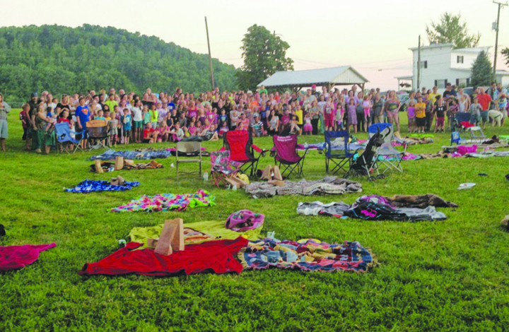 A large crowd turned out for the first Outdoor Family Movie night in Manchester on Friday, June 17.  Sponsored by the Adams County Junior Deputy Program, over 200 were in attendance.