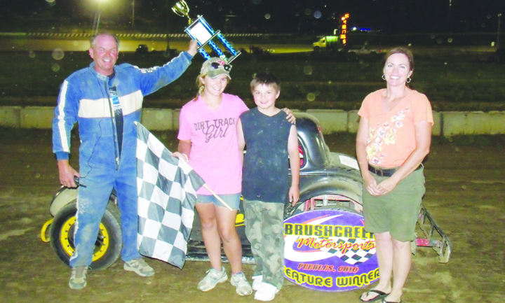 Tom Partin takes his Batman themed car to victory The Ohio Valley Roofers Legend Car Series.