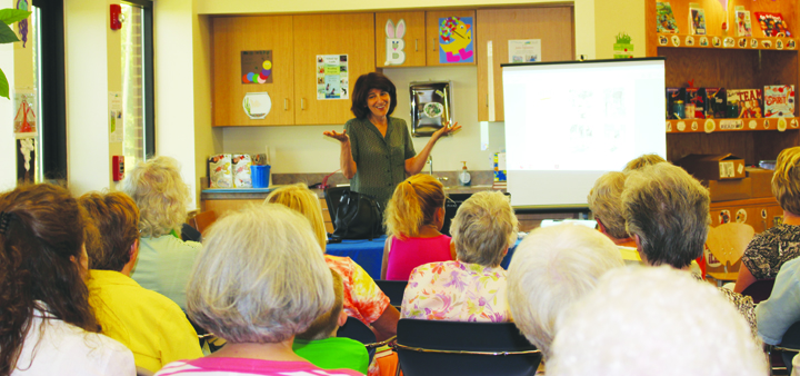 Local author Julie Salamon, center, explains the book-writing process to the audience assembled on June 11 at the North Adams Library.