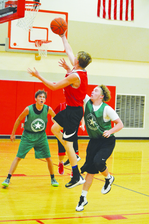 Peebles' Bostin Robinson soars to the rim in action last week against Huntington in the Hillsboro Shootout.