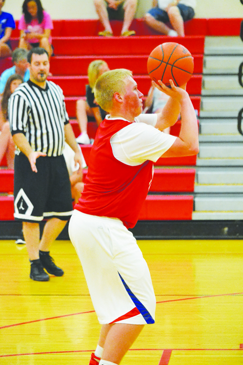 Peebles' Blake Smalley lines up this free throw attempt late in the action against Huntington in the June 17 shootout in Hillsboro.
