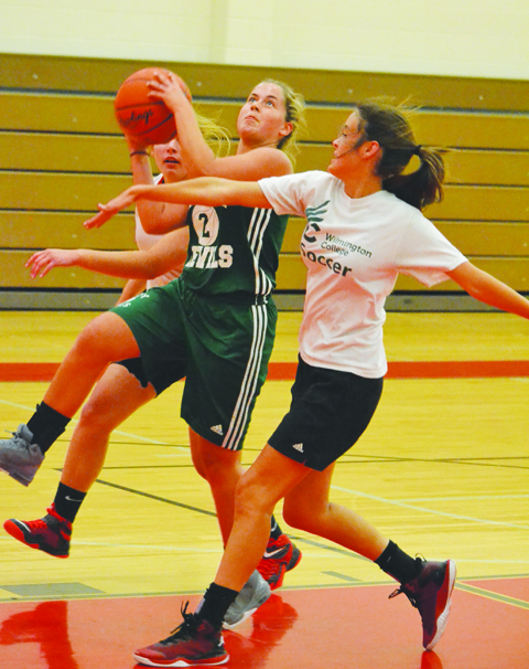 After making a steal, North Adams' Brooklyn Wylie drives in traffic to the basket for a score as the Lady Devils battled Fairfield at Eastern Brown High School on June 22.