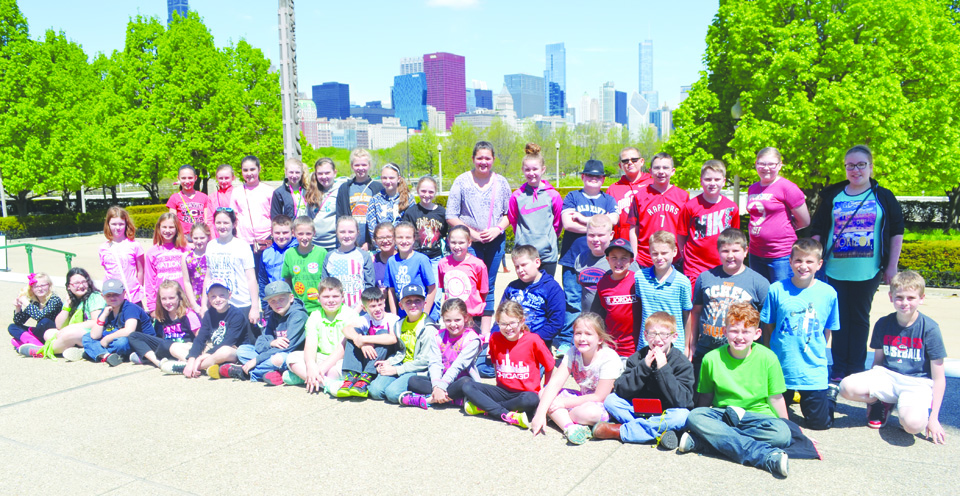 The students in the TAG program in the Adams County Ohio Valley Local School District recently made an end-of-the-year field trip to the city of Chicago.  Here, the students are shown in front of the city's skyline.