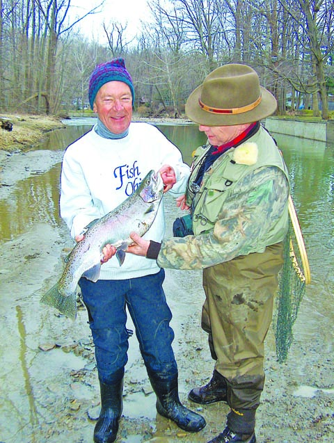 Tom Cross with the late U.S. Senator George Voinovich admiring a nice steelhead the Senator caught in 2005.