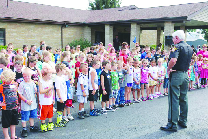 At his second Junior Deputy Boot Camp of the summer, this time in Peebles, Adams County Sheriff Kimmy Rogers speaks to a record turnout of youngsters.