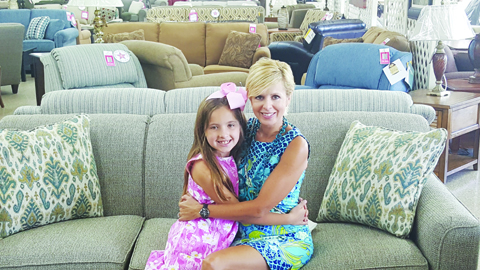Paula Aulino and daughter Lily Kate are seen here among the many furniture offerings at Chamblin Furniture in West Union.