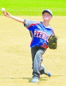 """Using his trusty first baseman's mitt, Peebles' Wyatt Cluxton moves to the pitcher's mound during the """"B"""" League All-Star Game on Saturday in West Union."""