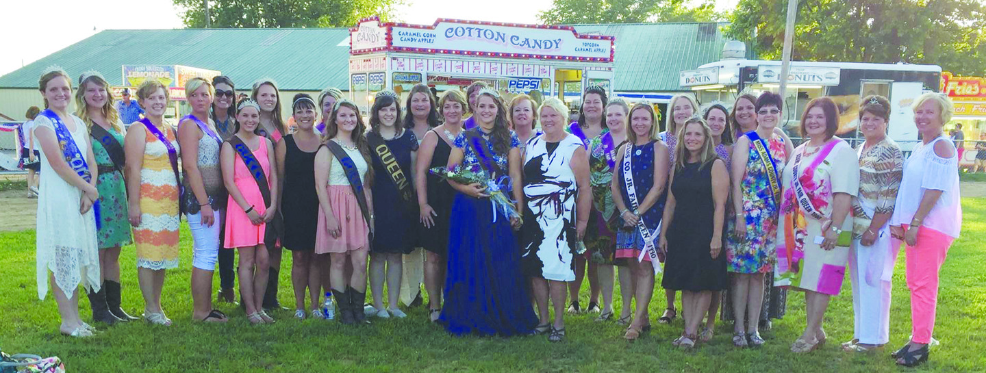 One of the highlights of the opening night of the 2016 Adams County Fair was the appearance of many of the Junior Fair Queens from the past 50 years. The past queens appeared in the opening parade and then were part of the audience at the 2016 Queen Pageant. Here, they are pictured with 2016 Queen Caitlin Young, center, who was crowned in ceremonies on Sunday evening at the fairgrounds.