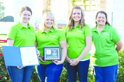 From Farm Credit Mid-America and honored on the opening night of the fair with the Friend of 4-H Award were, from left, Rudi Pitzer Perry, Cara Lawson, Lindsay Bloom, and Heather Simpkins.