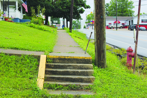 This section of sidewalk on south Main Street in Peebles is scheduled for repairs this week.