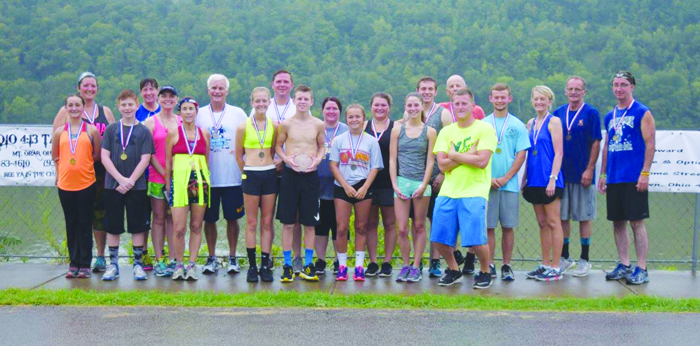 Though a rainy Saturday morning may have kept some runners away, over 30 braved the wet conditions to be a part of the 2016 River Days 5K race.  Pictured above are the winners in all the various age groups with Ethan Pennywitt being the top overall male runner and Ashley Hackworth the top overall female runner.  Photo by Michelle Bilyeu.