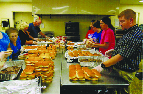 Junior Fair Beef BBQ volunteers helped make over 2,000 sandwiches for the 1,177 people served in 2015.