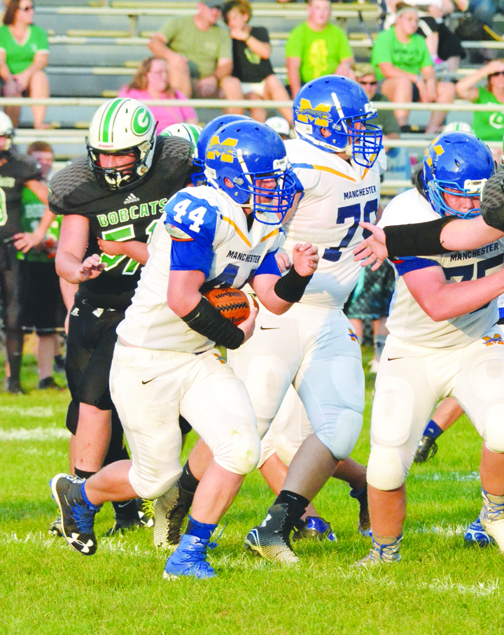 Manchester fullback Patrick Baldwin (44) looks for running room during first half action last Friday Night at Green High School.  Baldwin was a bright spot for the Greyhound offense, rushing for 94  yards, including a 74-yard touchdown run in the fourth quarter.