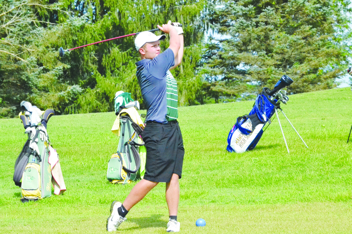 North Adams' Patrick England follows his shot from the fairway during action from last week's Adams County Cup.  England shot a 77 for the 18-hole tourney to earn All-County honors.