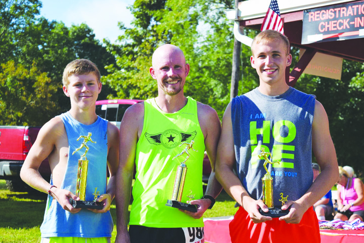 The top make runners in the 2016 Marine Corps 5K run were, from left, Ethan Pennywitt (17.486), Nathan Hauke (17.489), and Janson Kramer (19.47).  Photo by Michelle Bilyeu