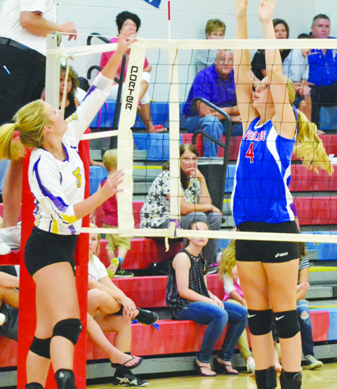 Peebles' Josie Myers, right, goes up at the net for the attempted block in Wednesday's match with Lucasville Valley.