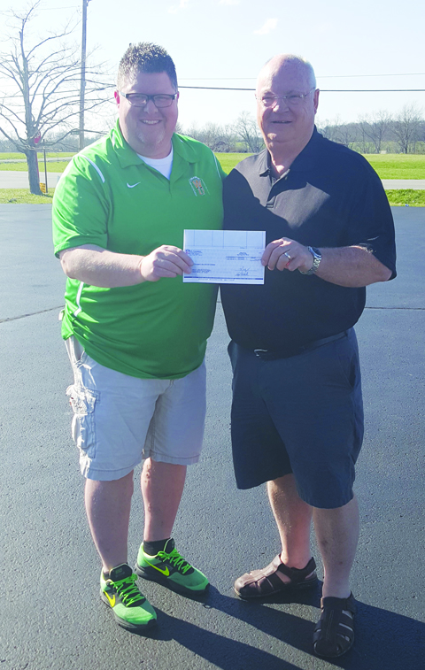 Scott McFarland, left, receives the check from the Bengals and the NFL Foundation from grant writer Ed Salsbury.