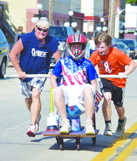 "A different kind of race headed down 2nd Street in Manchester on Saturday evening, this one appropriately called ""The Toilet Bowl Race.""  Photo by Michelle Bilyeu"