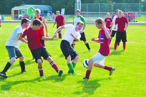 It looks as if nearly everyone on the field is involved in this play for the ball during action from last Friday night's pre-season soccer scrimmage between West Union and Peebles.