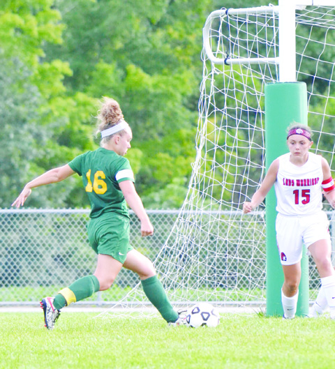 This shot by North Adams' Jordyn Kell (16) resulted in the only goal of the half as the Lady Devils topped Eastern Brown 1-0 in the SHAC Soccer Preview.