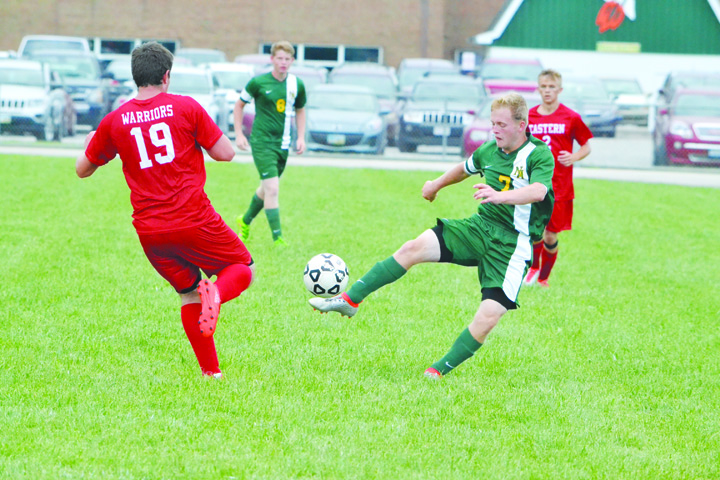 Coming out of the goal can be risky as the Eastern Brown keeper found out when he ran into North Adams' Tray Brand, center,  on this play from the SHAC Soccer Preview last Saturday in Fayetteville.