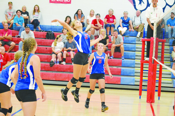 Peebles freshman Tatum Arey goes high for a kill attempt during the Lady Indians' four-set victory over Whiteoak last week.